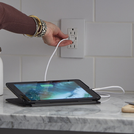 plugging tablet into radiant Collection GFCI USB outlet to charge