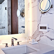 White bathroom with marble wall paper