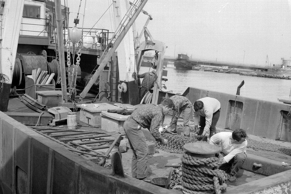 Crew working on gear on scallop boat