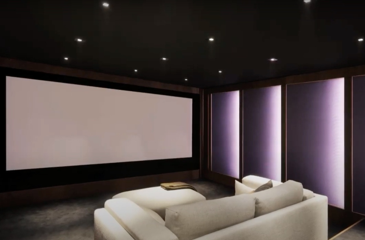 Residential movie theater with lights on a loveseat facing the screen