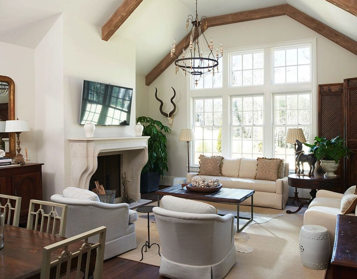 As continuity, the family room also has Benjamin Moore's York Gray walls for the neutral furnishings. The chandelier is by Aidan Gray.