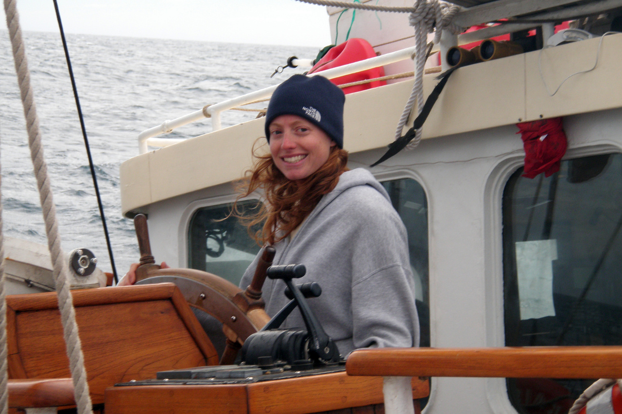 Heather at the helm of Research Vessel Kaisei in 2009 in the middle of the Pacific Ocean.