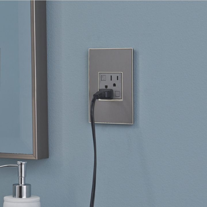 adorne Collection gfci outlet in magnesium with cord plugged in
