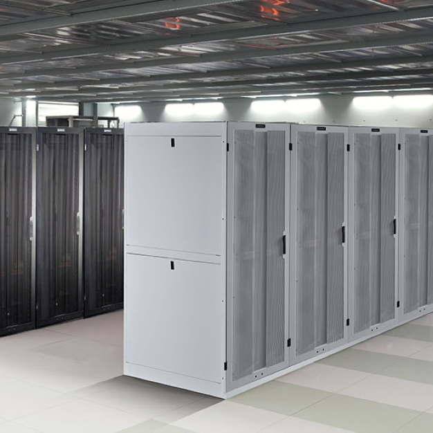 White and black server cabinet containers in a data center