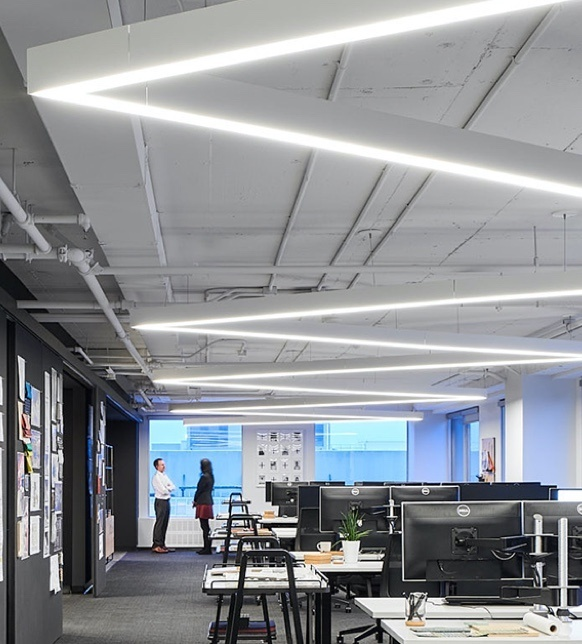 Rectangular lighting fixtures in an open office space