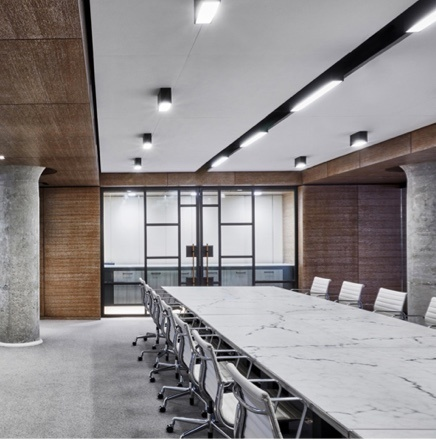 Recessed Lighting in board room with marble table and white chairs