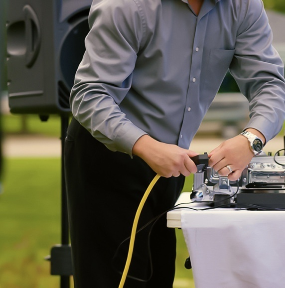 guy plugging in electrical device outdoors