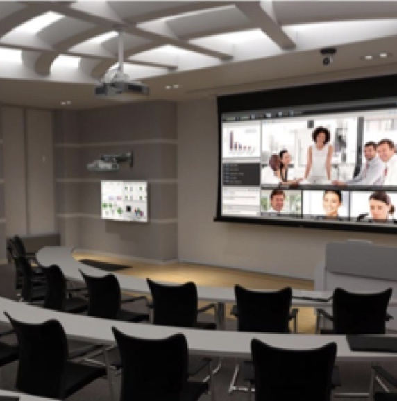 Lecture hall with a large projector screen at the front of the room