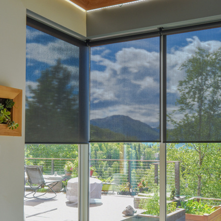 residential shades on windows overlooking deck