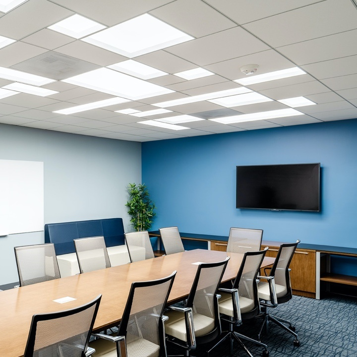 LiFT lighting in empty conference room with blue wall