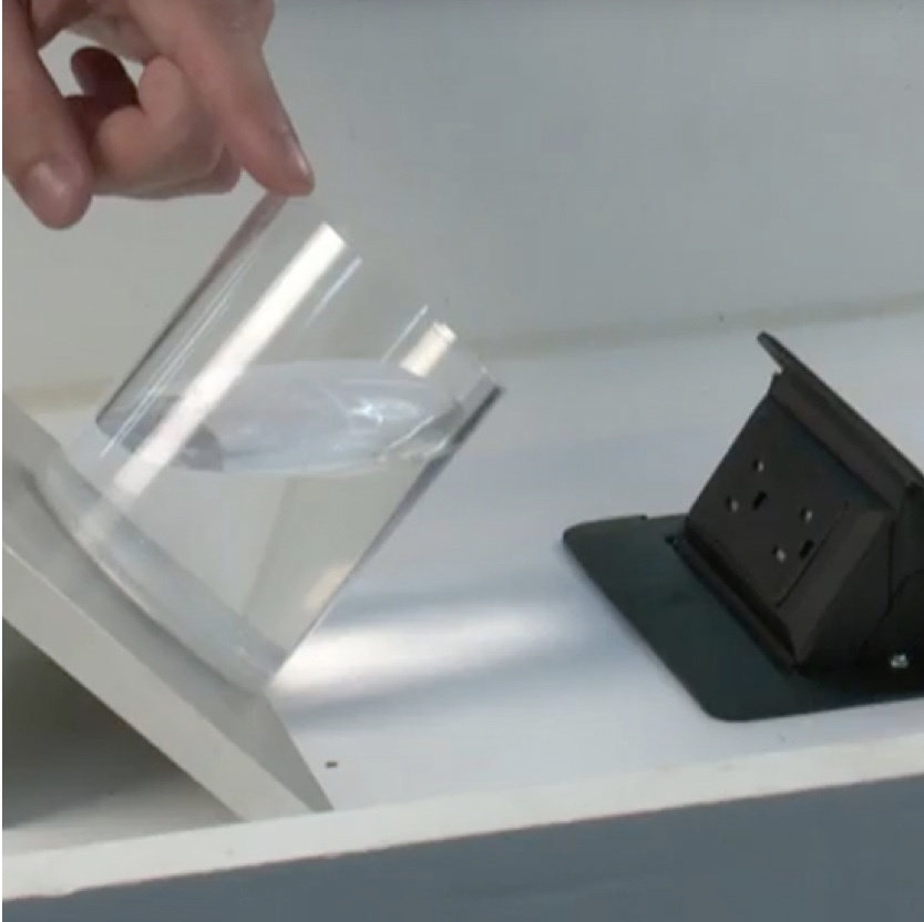 dequorum flip up table boxes in table testing water spill