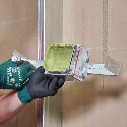 Contractor with gloved hands installing EZE-fab branch-circuit wiring