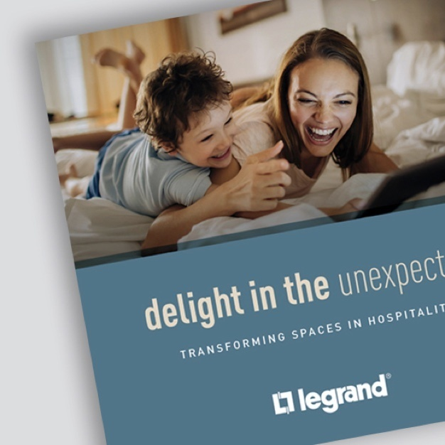 """image of brochure cover with """"delight in the unexpected"""" written on the front and showing a mother a child laughing towards a laptop screen"""