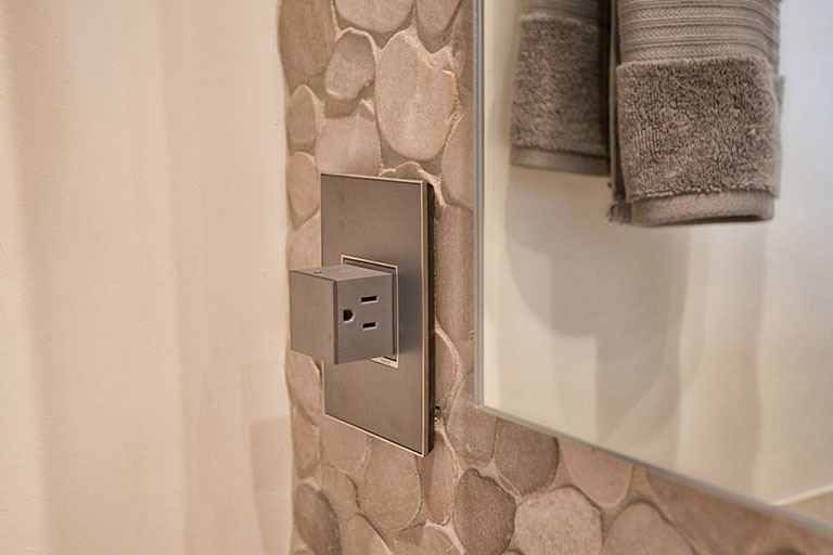 adorne Magnesium Pop-Out Outlet in Bathroom next to shower