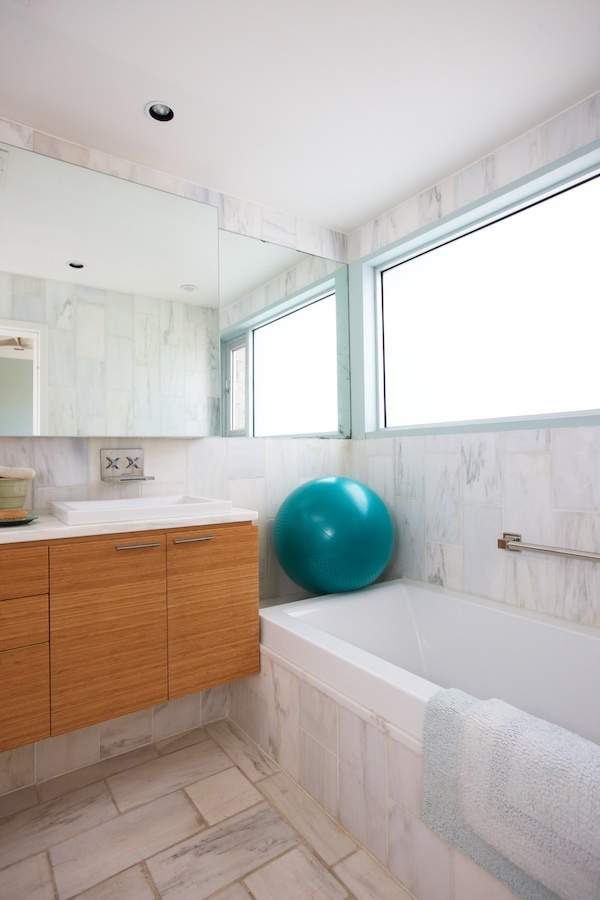 """Reclaimed Alabama white marble from a construction site a few blocks away was salvaged, cut and became the stone tile in the guest and master baths,"" says Jeremy."