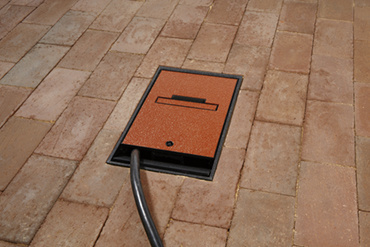 Wiremold Outdoor Ground Box in brick with cords