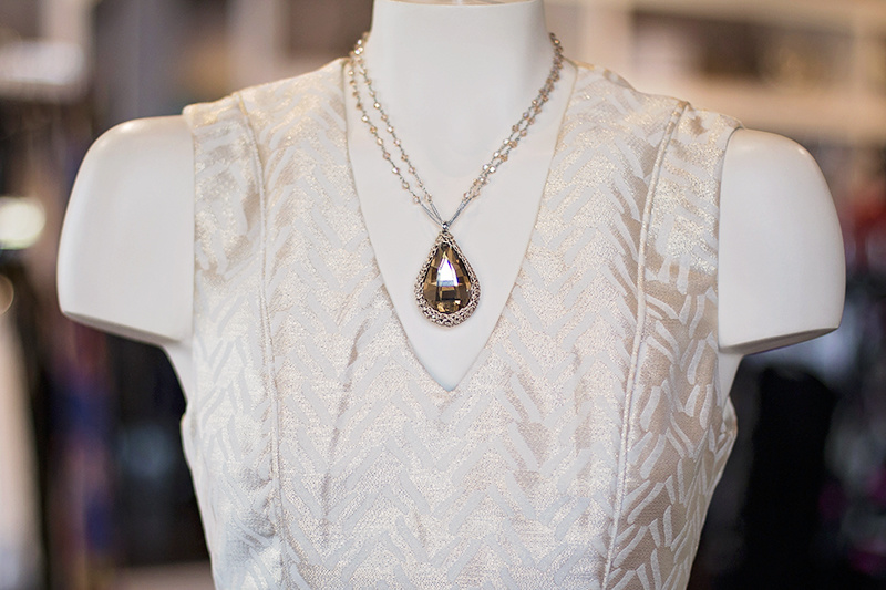 The amber necklace brings out the subtle and sophisticated shimmer of this dress.