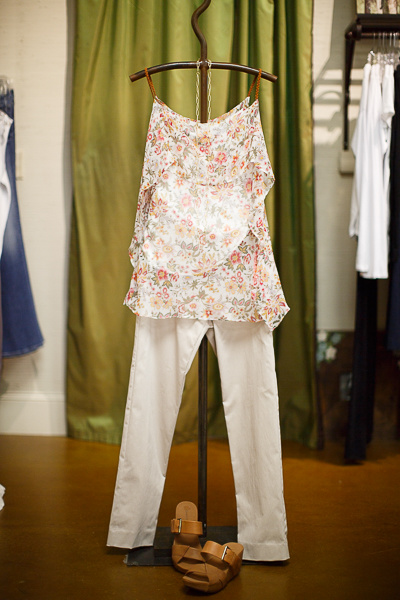 From Sorelle: Bailey|44 tiered floral top with braided leather straps, $206; Crazy Larry khaki fitted pants, $104 and Gold + Stone link necklace, $60