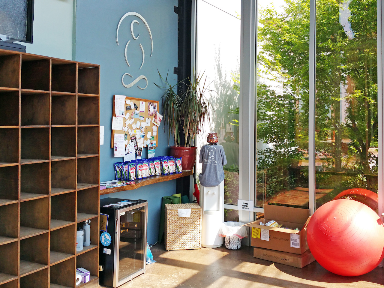 The large, airy sunroom studio at The Yoga Circle has cubbies, water and energy snacks, as well as an exercise ball and weights.