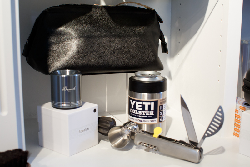 From Social, a Shop for Gracious Living: Dopp kit, $34; portable Bluetooth speaker, $86; Bar 10der, $41.99; and Yeti Colster, $29.99
