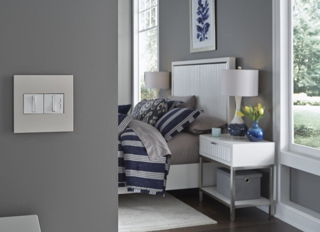 adorne Collection by Legrand light switches and dimmers of gray bedroom wall