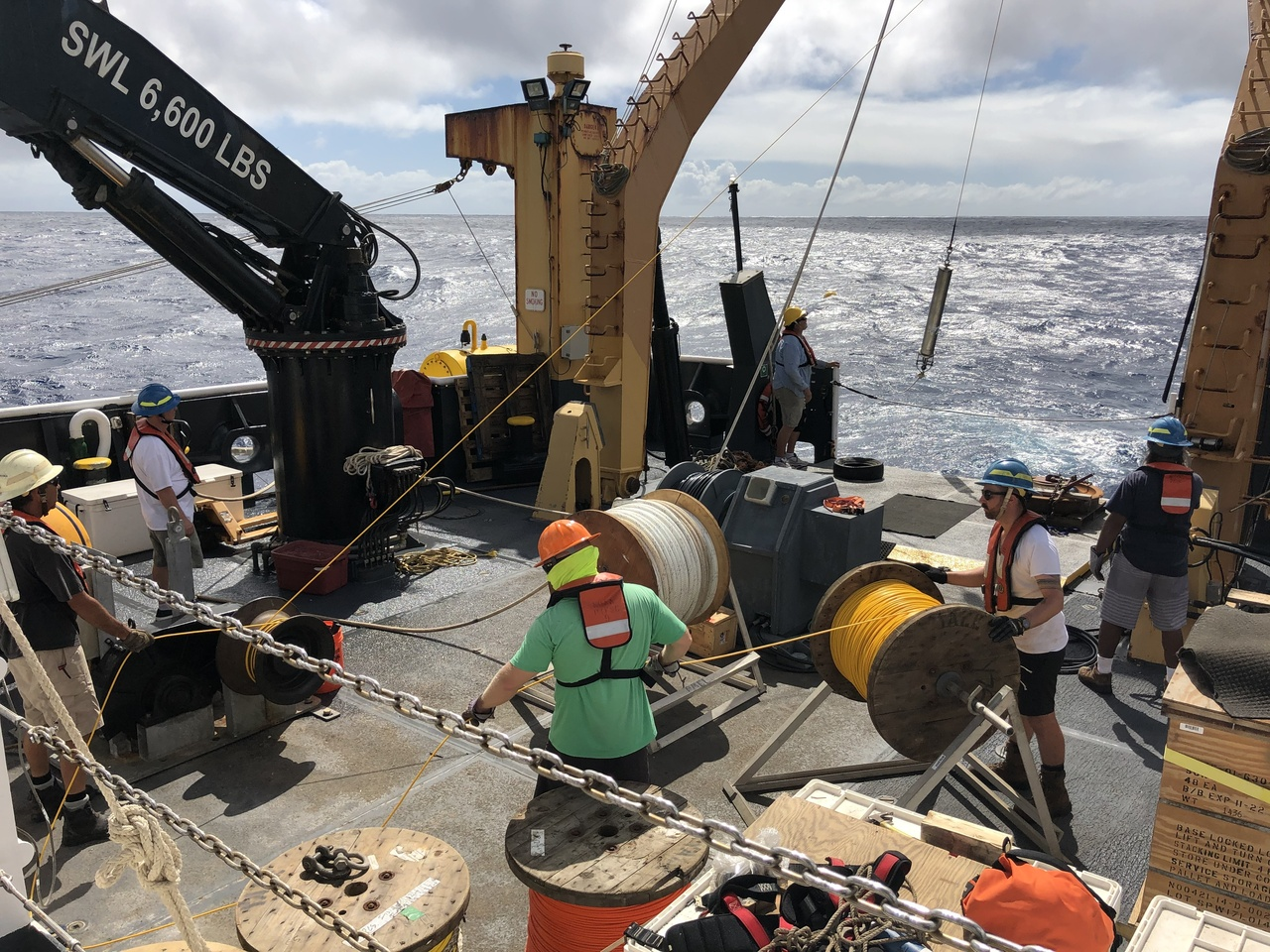 The entire Sette deck crew and CRP staff member, Erik Norris, were involved in the recovery and redeployment of the PMEL listening station device. The recovered recording device was deployed in July during our 2017 HICEAS project, https://www.fisheries.noaa.gov/feature-story/heading-high-seas-hawaiian-islands-cetacean-and-ecosystem-assessment-survey, and today a new recording device is lowered into the water during the redeployment. For more information on the acoustic recorder, check out https://www.pmel.noaa.gov/acoustics/noaanps-ocean-noise-reference-station-network and https://www.st.nmfs.noaa.gov/feature-news/acoustics. Photo: NOAA Fisheries/Marie Hill.