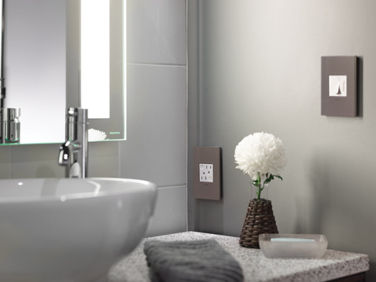 adorne Light Switches, Outlets, and Wall Plates in hotel bathroom