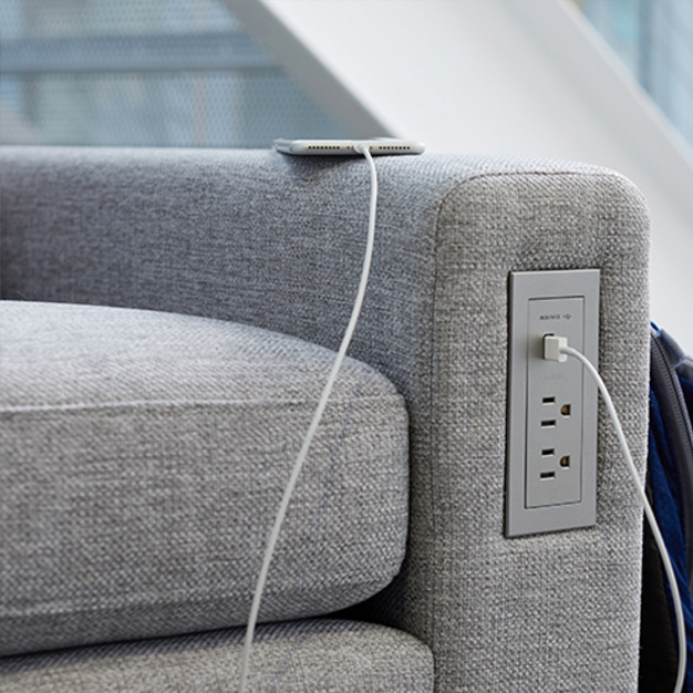 Furniture power center installed on upholstered chair with USB phone charging