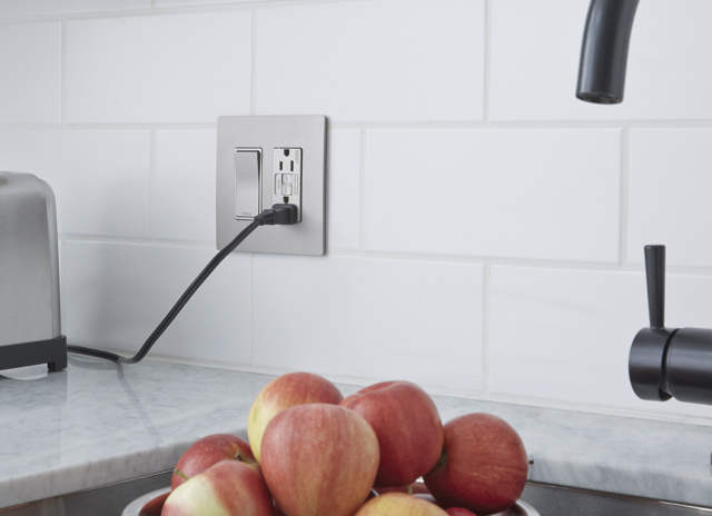 radiant gray outlets and switch providing power to toaster in white kitchen