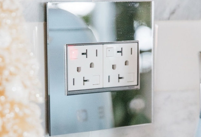 Legrand adorne Collection white GFCI outlets in mirrored wall plate