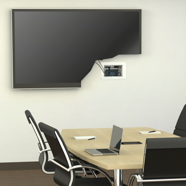 Meeting room with TV with portion cutout to show Evolution wall box