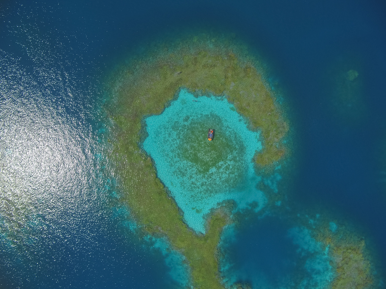 A striking aerial view of a section of the Pearl and Hermes Atoll. A part of the Papahānaumokuākea Marine National Monument, the reef area of this atoll spans over 450 square miles (194,000 acres).(Photo: NOAA Fisheries/Steven Gnam)