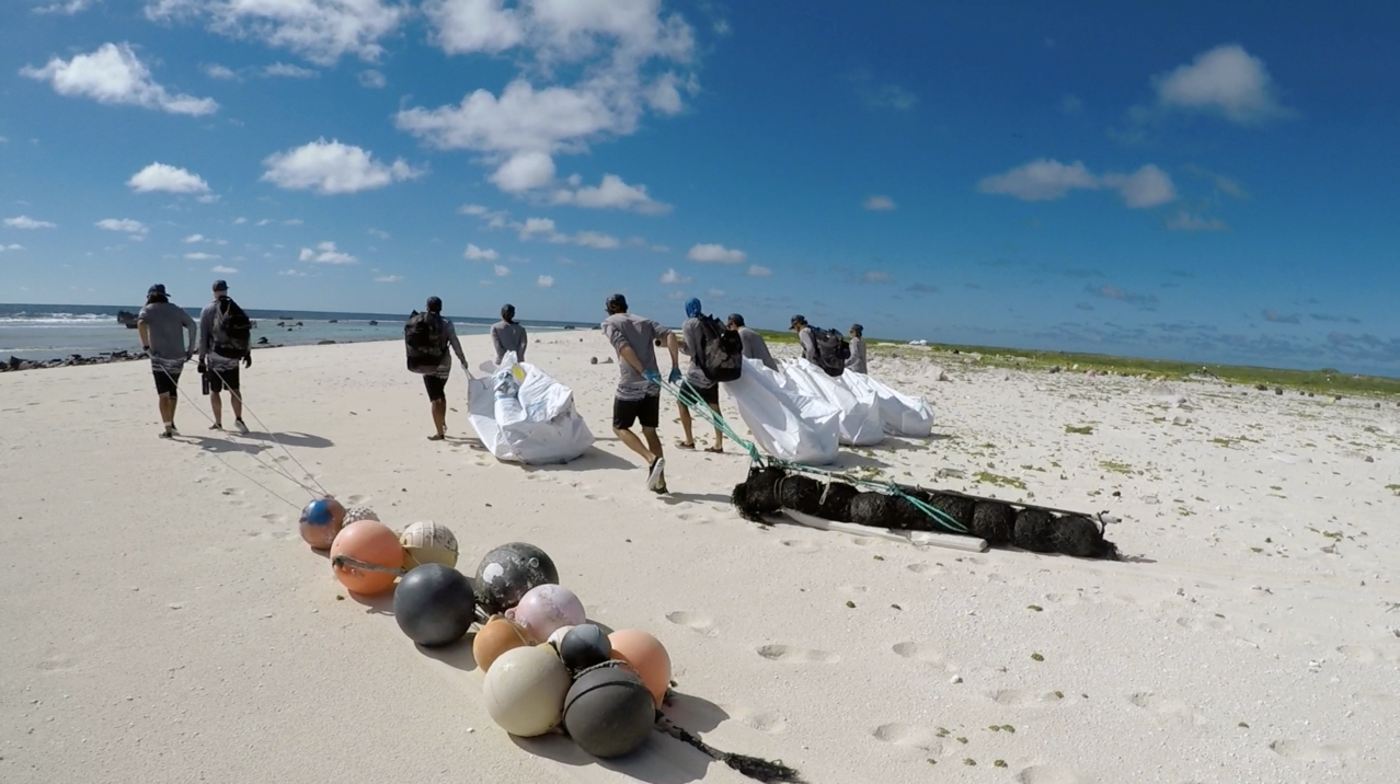 The long haul of marine debris 1.8 miles along the shores of Laysan Island