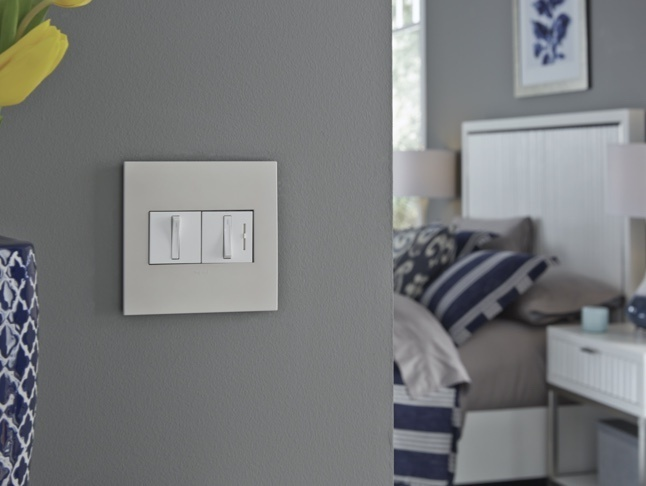 adorne Collection light switch and dimmer installed in bedroom