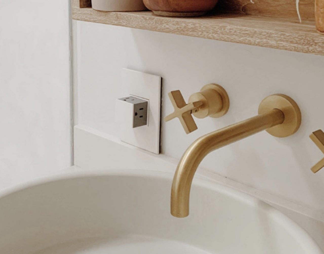 Legrand adorne Collection white pop out outlet next to bathroom sink