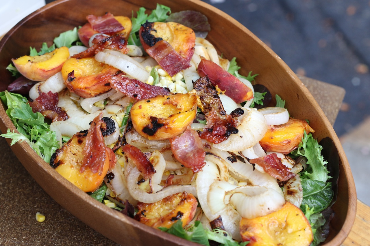 From StyleBlueprint: Grilled Peach, Onion, Corn and Bacon Salad