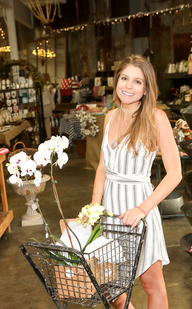 Lucy, the store's namesake, handles flowers as well as social media and PR for Lucy's Market.