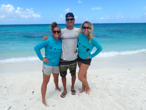 """Marylou, Jan Willem, and Alex (L-R) pose on their camp """"front porch"""" on East Island. Photo: NOAA Fisheries"""