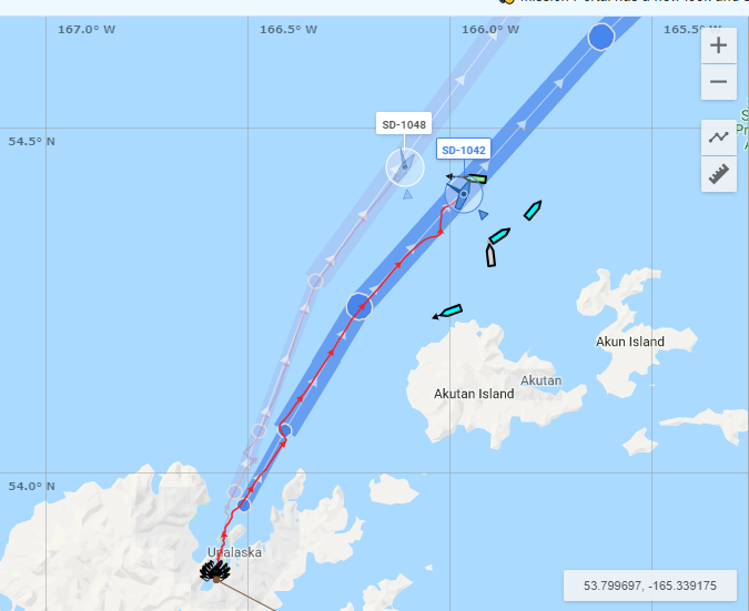 Two Saildrones passing other vessels near Akutan Island, less than a day after leaving Dutch Harbor (red is drone track, blue is planned track)