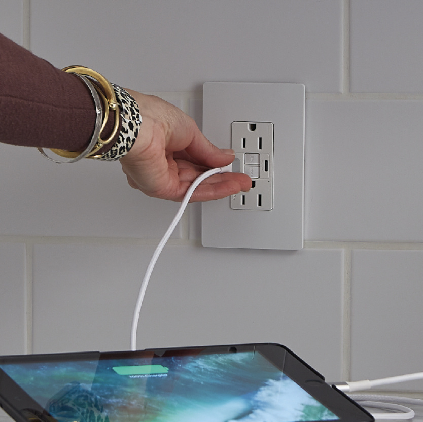 tablet plugged into GFCI USB outlet in modern kitchen