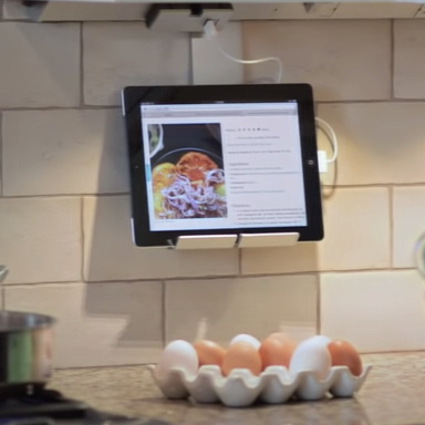 Eggs on kitchen counter with recipe on tablet