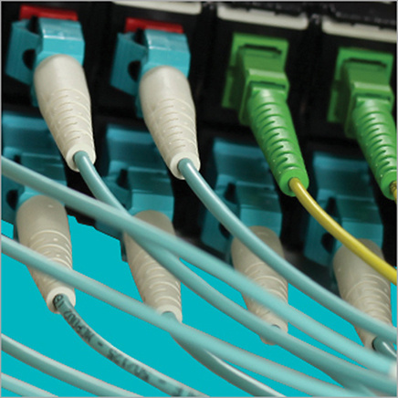 Teal and green cables for data center rack