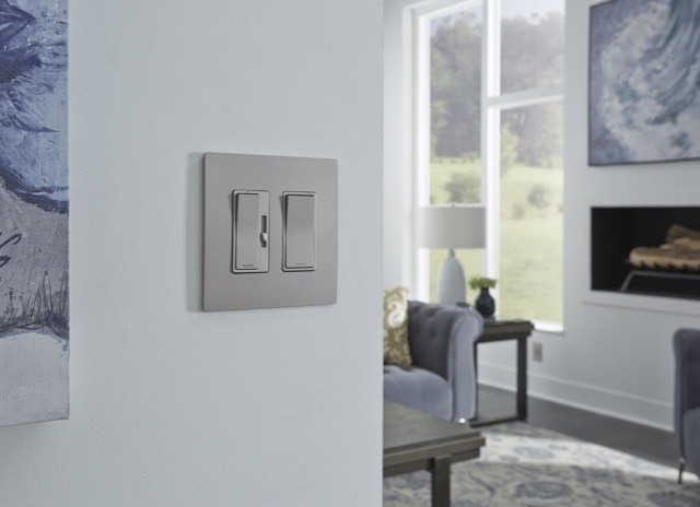 Gray radiant dimmer and switch against white wall in living room