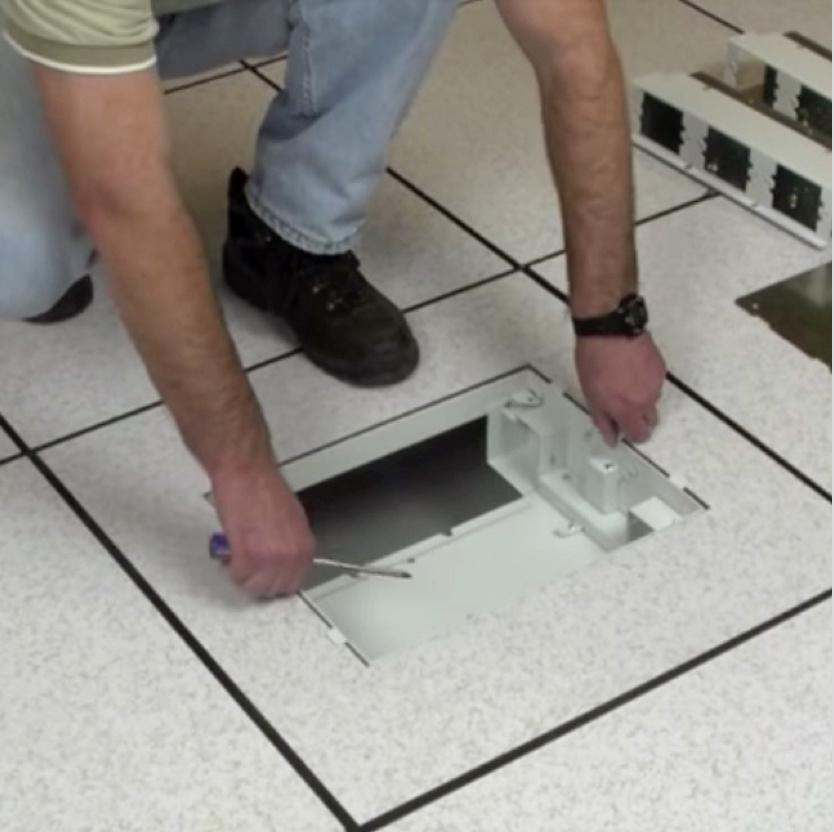 Contractor installing floor box in tile floor