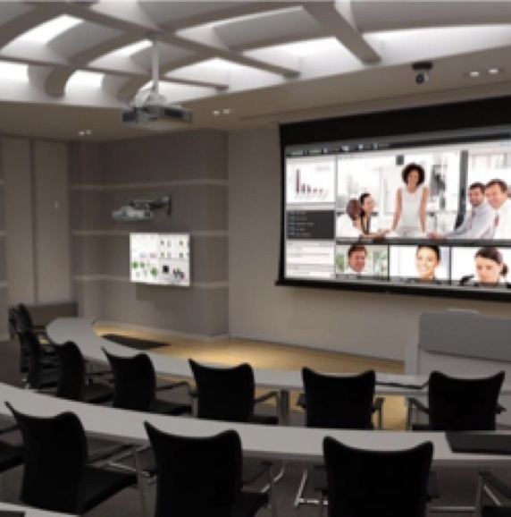 Auditorium style classroom with large projector screen dropped down from the ceiling