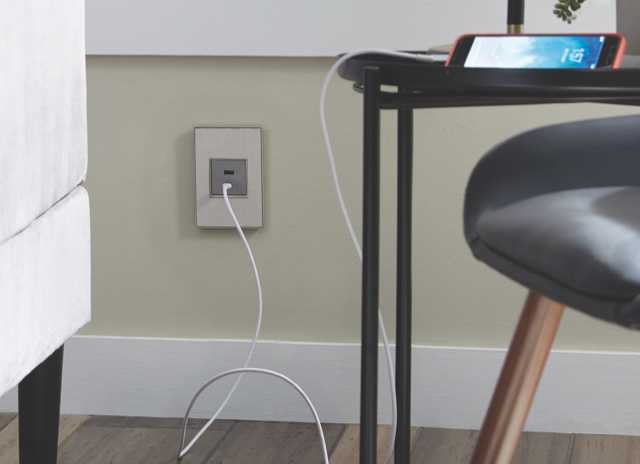 adorne USB Type A/C outlet in magnesium with charging cord plugged in