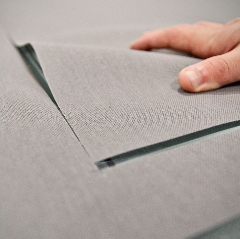 Close up of gray shading fabric being cut
