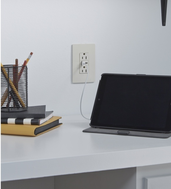 radiant Collection by Legrand USB-A/C outlet above desk with tablet plugged in to charge