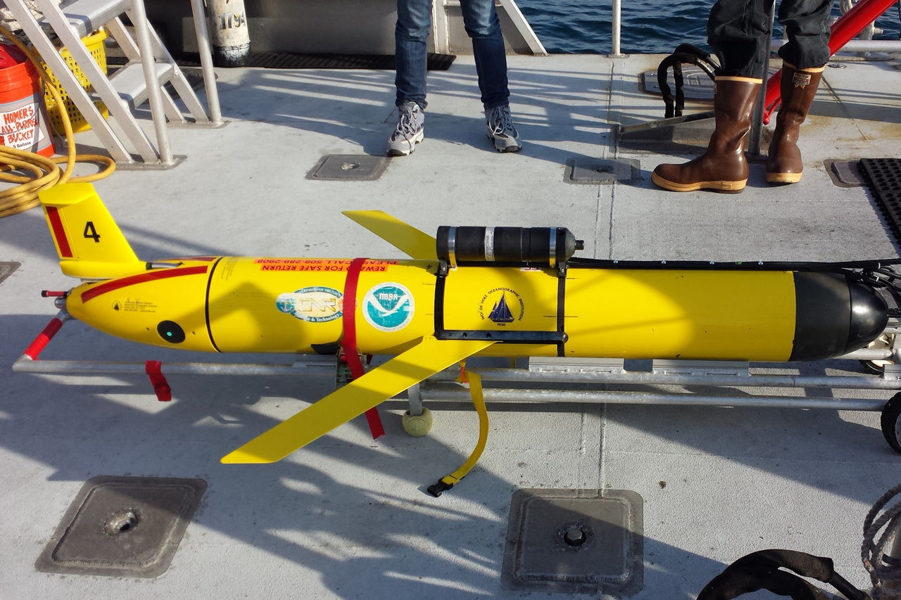 Side view of a glider with acoustic recorder attached on ship deck before deployment