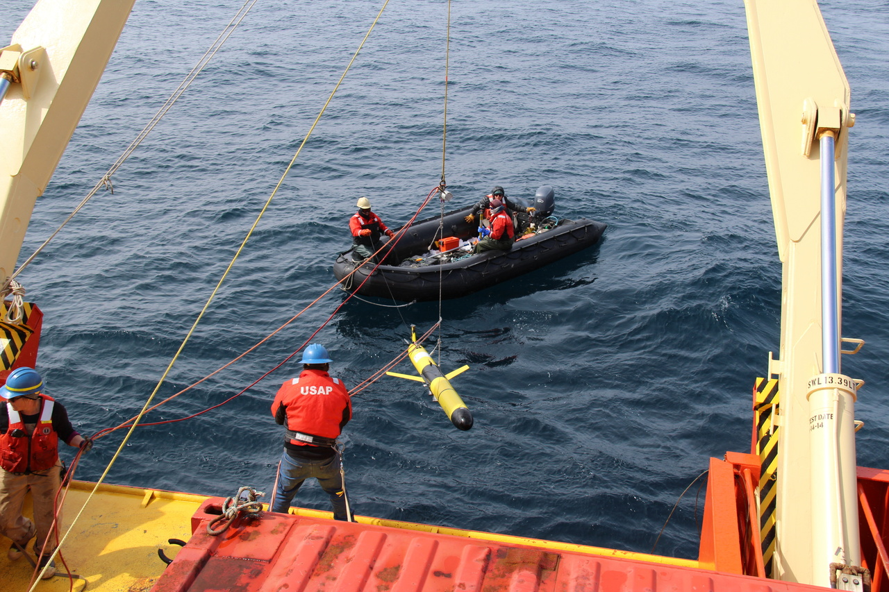 A research glider is deployed from the back of the ship.